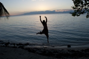 Hannah jumping in front of the sunset