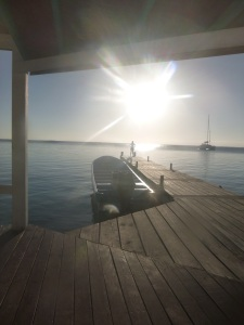 Our last morning at South Water Caye, the sun rising over the dock.